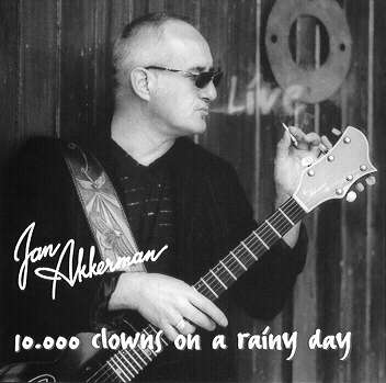 Jan Akkerman 10,000 Clowns On A Rainy Day - LIVE album cover