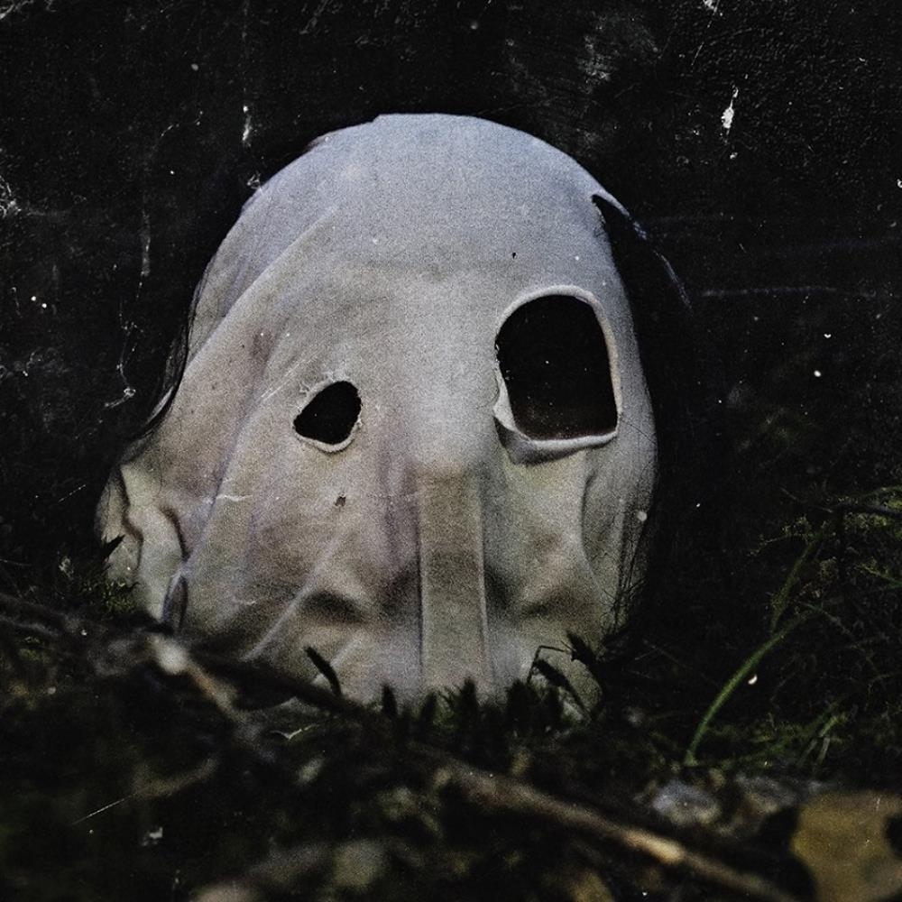 In Becoming A Ghost by FACELESS, THE album cover