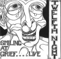 Smiling At Grief...Live by TWELFTH NIGHT album cover