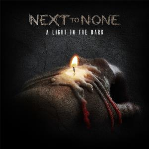 A Light in The Dark by NEXT TO NONE album cover